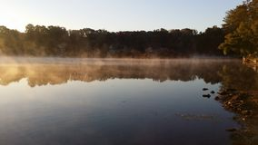 Lake sunrise fog Royalty Free Stock Photo