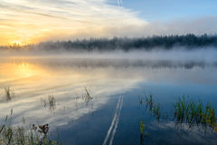 Lake sunrise fog sun mist Royalty Free Stock Photos