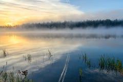 Lake sunrise fog sun mist Royalty Free Stock Photos