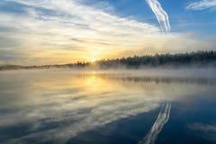 Lake sunrise fog sun mist Royalty Free Stock Photo