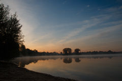 The lake at sunrise Royalty Free Stock Photos