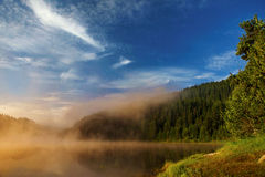 Lake at sunrise. In the Rhodope Mountains in Bulgaria Stock Images