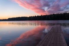 Lake sunrise sky clouds Royalty Free Stock Photos