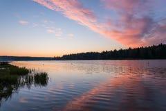 Lake sunrise sky clouds Stock Image