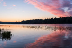 Lake sunrise sky clouds Stock Images