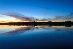 Lake sunrise sky clouds reflection Royalty Free Stock Image