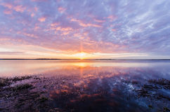 Lake sunrise. Taken at 5:30am with wide angle lens Royalty Free Stock Photo