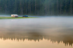 Lake at sunrise. With trailer in the Rhodope Mountains in Bulgaria Royalty Free Stock Photos