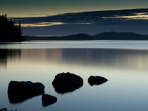 Lake Sunset. A beautiful sunset at the edge of a lake Royalty Free Stock Image
