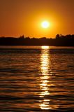 Lake Sunset. Orange Sunset over Rippled Lake Royalty Free Stock Image