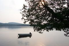 Lake at Sunset. An old boat stock photography