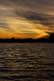 Lake at sunset. The picture shows a lake during sunset stock photography