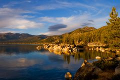 Lake at sunset. With black cloud over the water Stock Image