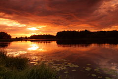 Lake at sunset Stock Images