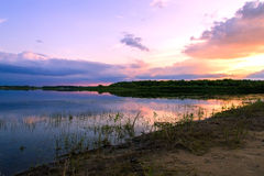 Lake on the sunset background Stock Image