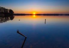 Lake at sunset. Boats mooring place. Royalty Free Stock Photo