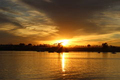 Lake Sunset carnival in distance. Beautiful sunset over a Lake with a carnival in the distance Royalty Free Stock Photography