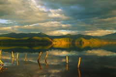 The lake at sunset. Sunset hours when the soft light is shining on the Lugu Lake is really a comfortable eye-feast for visitors Royalty Free Stock Photo