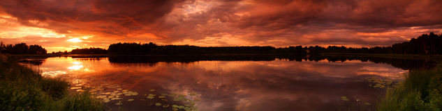 Lake at sunset panorama Stock Photos
