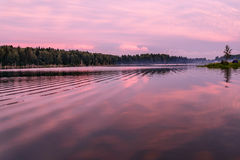 Lake sunset pink clouds sky Royalty Free Stock Photo