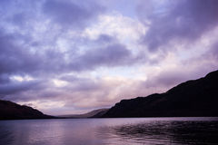 Lake at sunset with purple sky Stock Photo