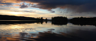 Lake Sunset and Rain Cloud. Sunset over Lake in Finland, Scandinavia, with Rain Cloud royalty free stock photography