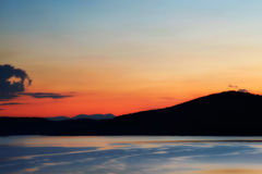Lake at sunset. In the Rhodope Mountains in Bulgaria stock images