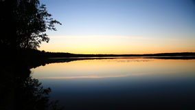 Lake at sunset Stock Photography