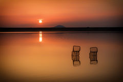 Lake Sunset. Two Fishing nets in a lake on sunset in summer with red sky in Bulgaria close to Belogradchik rocks Stock Photos