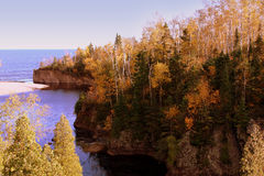 Lake Superior. A river running into Lake Superior, along the MN coast.  The fall leaves are in their peak.  The colors are magnificent Stock Image
