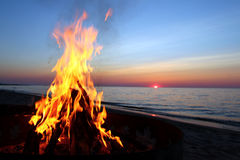 Lake Superior Beach Campfire. A beautiul sunset and Lake Superior Beach Campfire Royalty Free Stock Photo