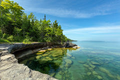 Lake Superior Paradise Cove in Au Train Michigan. The clear waters of Lake Superior reveal large rocks and stones underwater. This cove, with pristine waters, is Stock Images