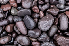 Lake Superior Rocks. Wet stones on the shore of Lake Superior in Michigan`s Upper Peninsula stock photos