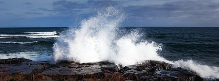 Lake Superior Shore. A wave crashing over the rocky shoreline of Lake Superior Royalty Free Stock Photography