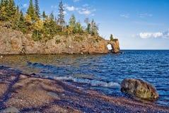 Lake superior shoreline, arch. Rocky lake superior shoreline, jutting peninsula with arch Stock Photography