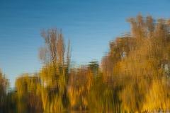Lake surface in autumn. Lake surface reflecting autumn trees Stock Photo