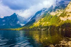 The lake is surrounded by high mountains royalty free stock image