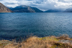 Lake surrounded by mountains Royalty Free Stock Image