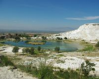 Lake surrounded with white Travertine in Pammukale Stock Photos