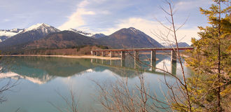 Lake sylvenstein with bridge and water reflection Stock Image