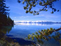 LAKE TAHOE. View of Lake Tahoe with snow covered mountains in background Stock Photography