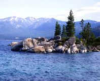 LAKE TAHOE. View of Lake Tahoe with snow covered mountains in background Royalty Free Stock Photography