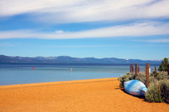 Lake Tahoe. A waiting kayak on a deserted Tahoe beach on a beautiful sunny day Stock Photography