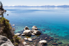 Lake Tahoe. Beautiful day at Lake Tahoe, clear blue water reflecting the blue sky Stock Images