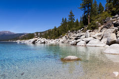 Lake Tahoe. Beautiful day at Lake Tahoe, clear blue water reflecting the blue sky Stock Photo