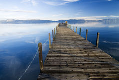 Lake tahoe blues. Lake tahoe wooden pier at sunset Stock Photos