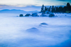 Lake Tahoe boulders appear floating in fog Royalty Free Stock Photos