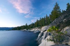 Lake Tahoe Coast at Night. A Night image of the rock and forest covered shoreline of Lake Tahoe in Nevada Stock Image