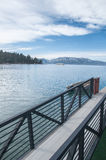 Lake Tahoe Harbor. Beautiful Lake Tahoe shore overseeing the snowy mountains and bright blue sky Stock Images