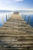 Lake tahoe lake and sky. Lake tahoe wooden pier at sunset royalty free stock image